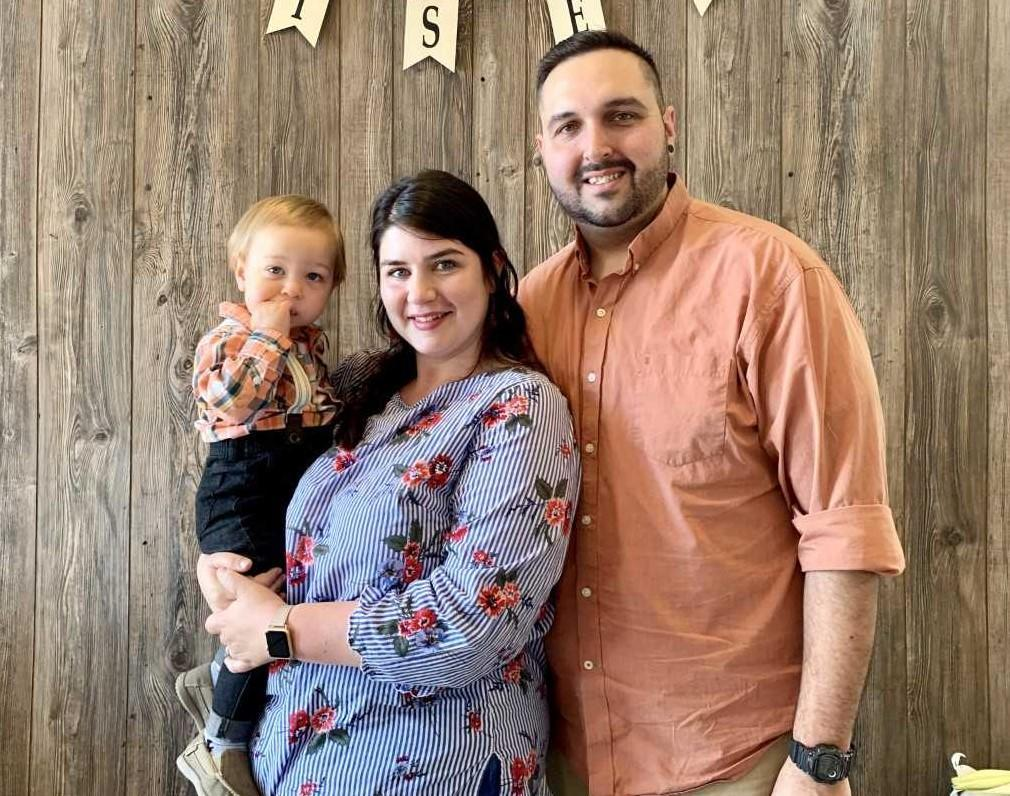 Mrs. BT, her husband Brant, and her son William posing together at Easter