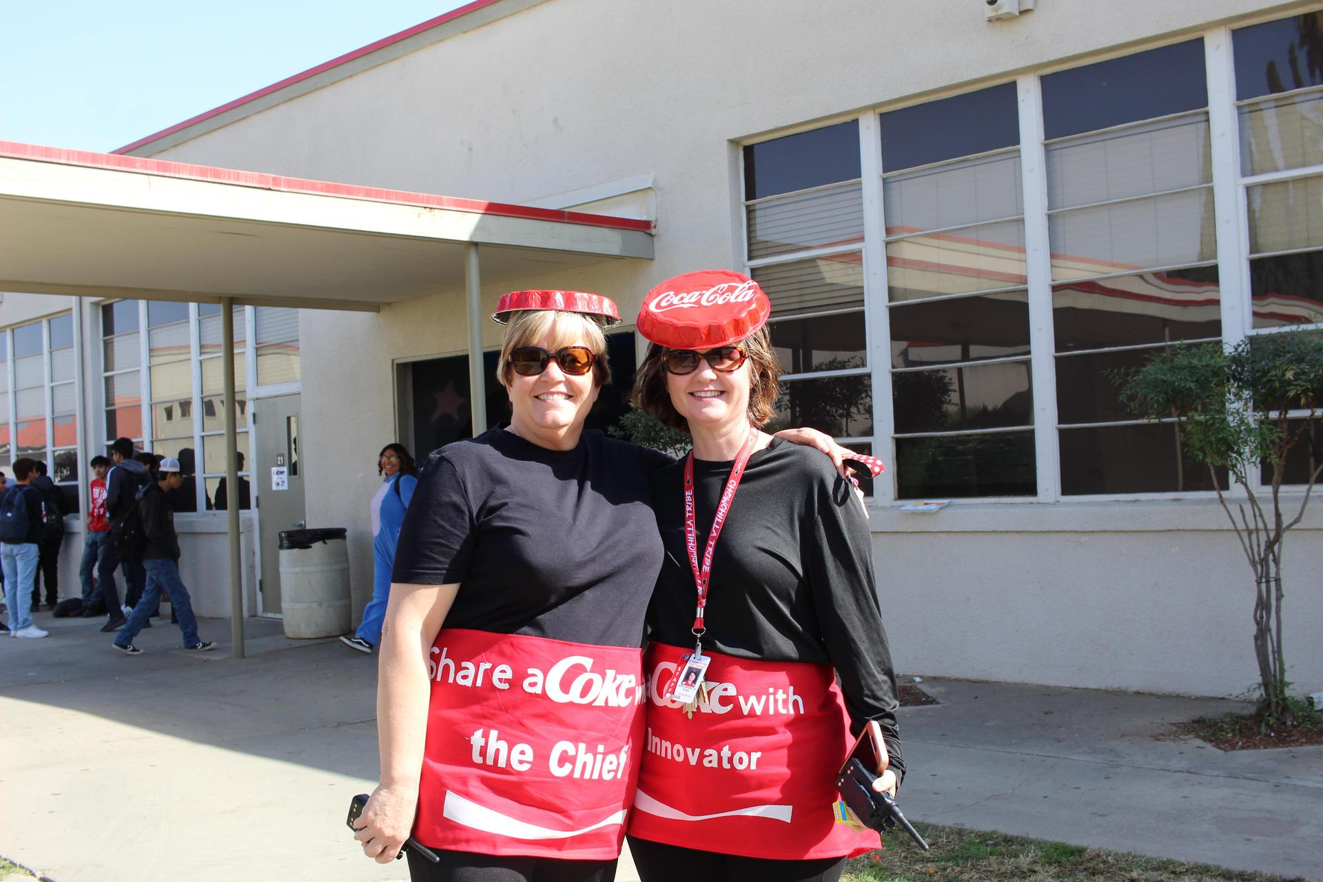 Mrs. Castillo and Ms. Ross dressed as Coke bottles