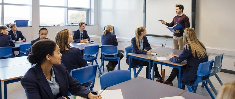 Photo of Westminster private school teacher talking to a full classroom of high school students