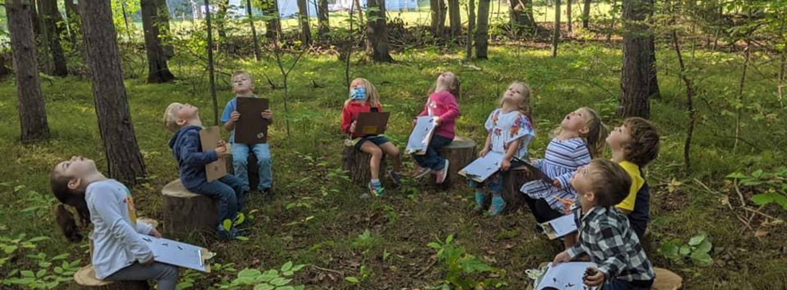 outdoor preschool classroom. kids looking at sky