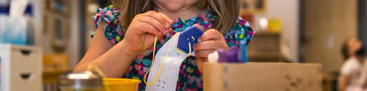 Children's House button sewing