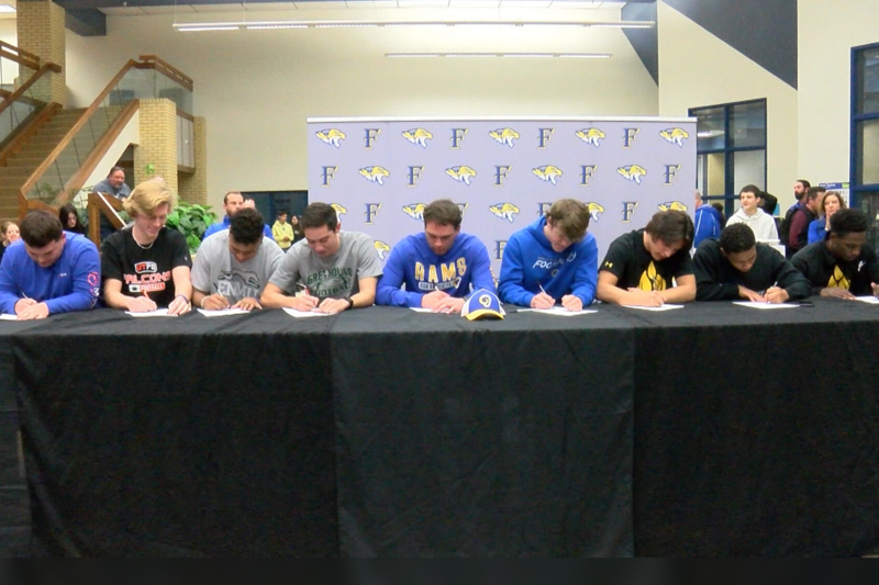 9 sign to play football at college level