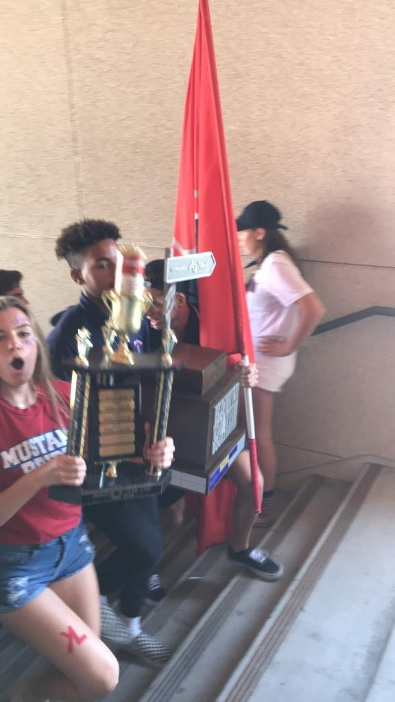 Battle of the Blvd trophy going upstairs during rally