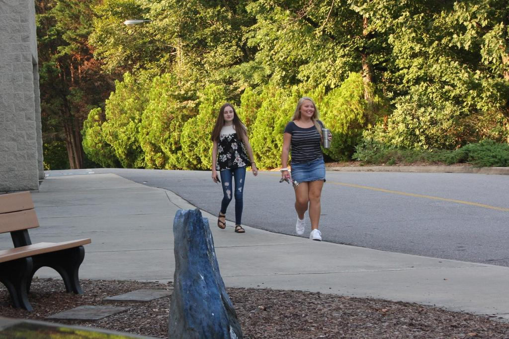 Two young ladies arrive for the first day of school at Wilkes Early College.
