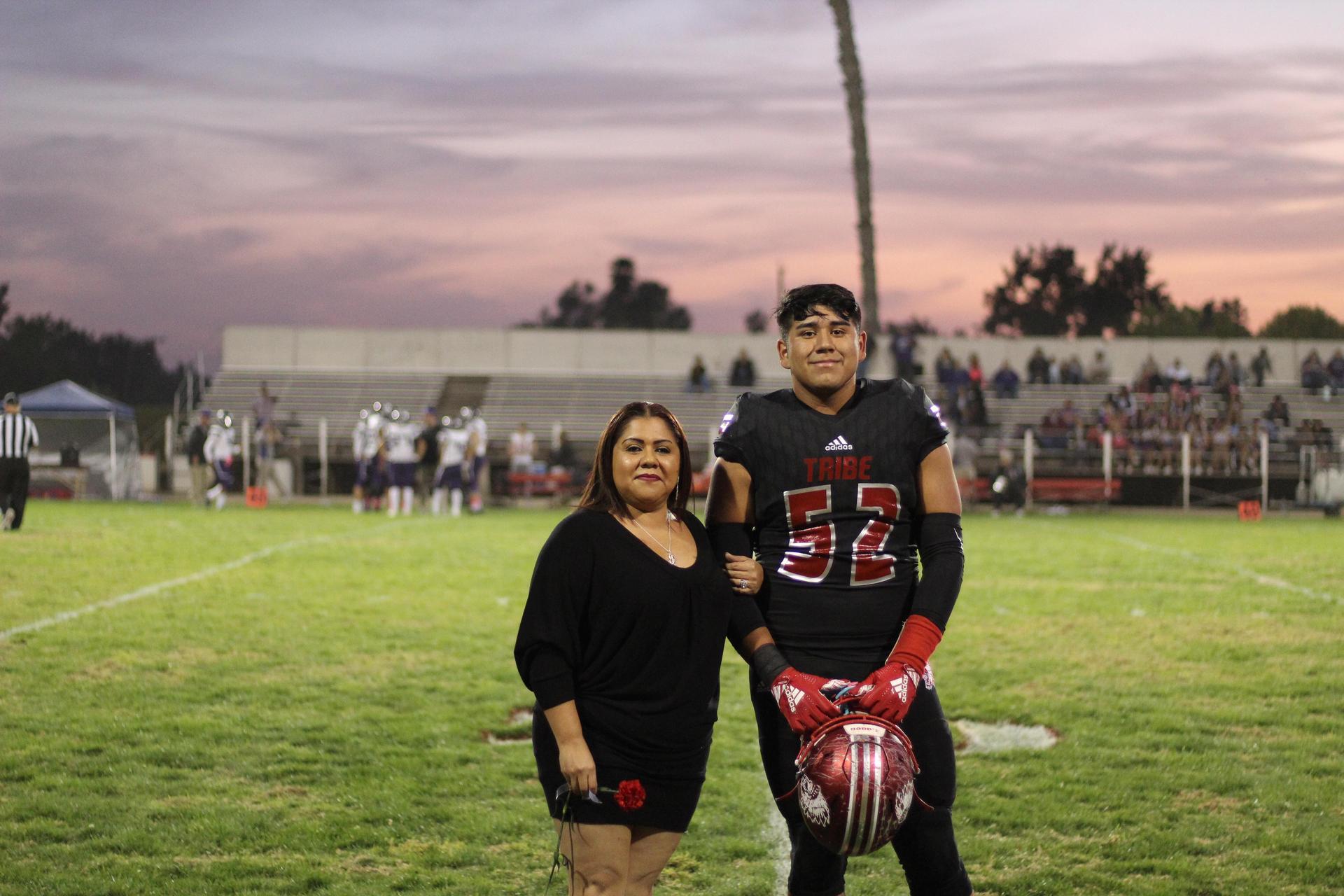 Senior football player Damian Rodriguez and his escort.