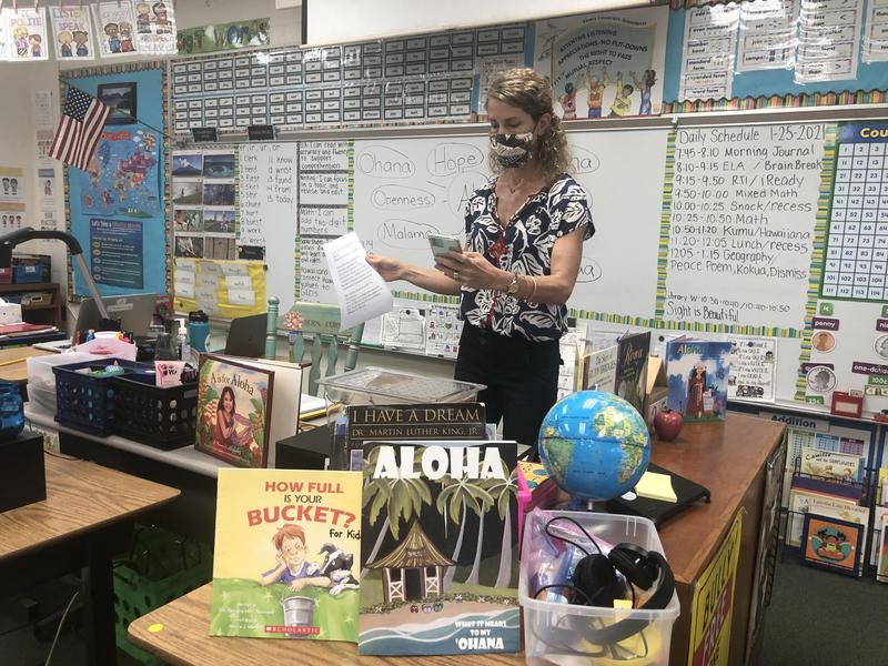 Mrs. Cornell shares the Aloha Book