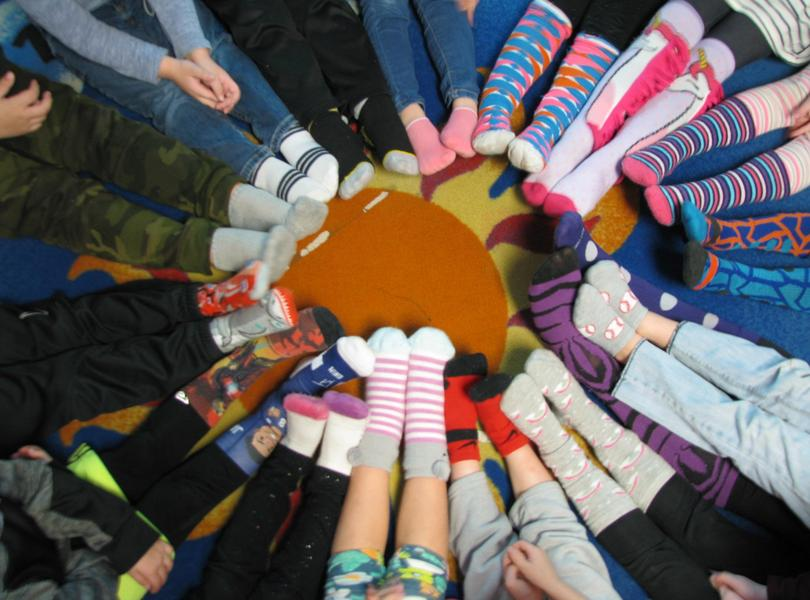 Kindergarten circle of crazy socks in celebration of Dr. Seuss's Birthday