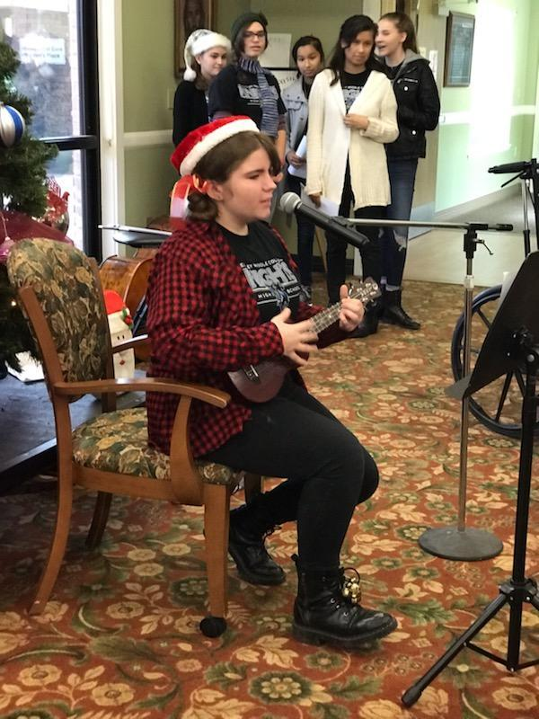 RMCHS student plays the guitar at Sierra View Homes.