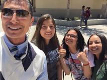 Mr. Olguin in a selfie with students.