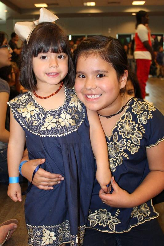two girls smiling for camera