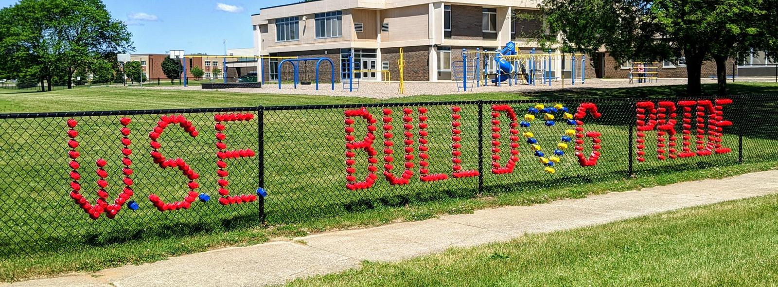 sign in fence says WSE bulldog pride