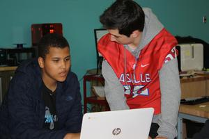 two boys studying