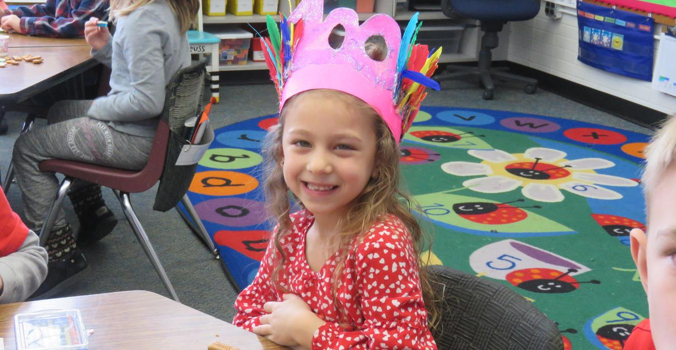 Students make fancy hats to celebrate 100th day of school.