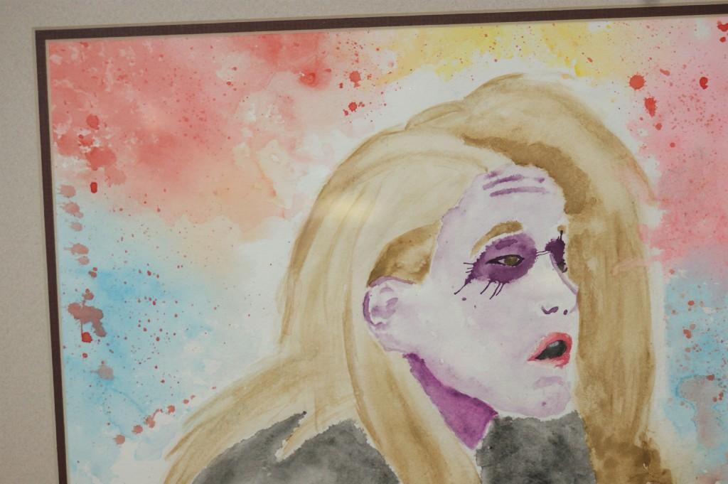 Student makes abstract painting of a women