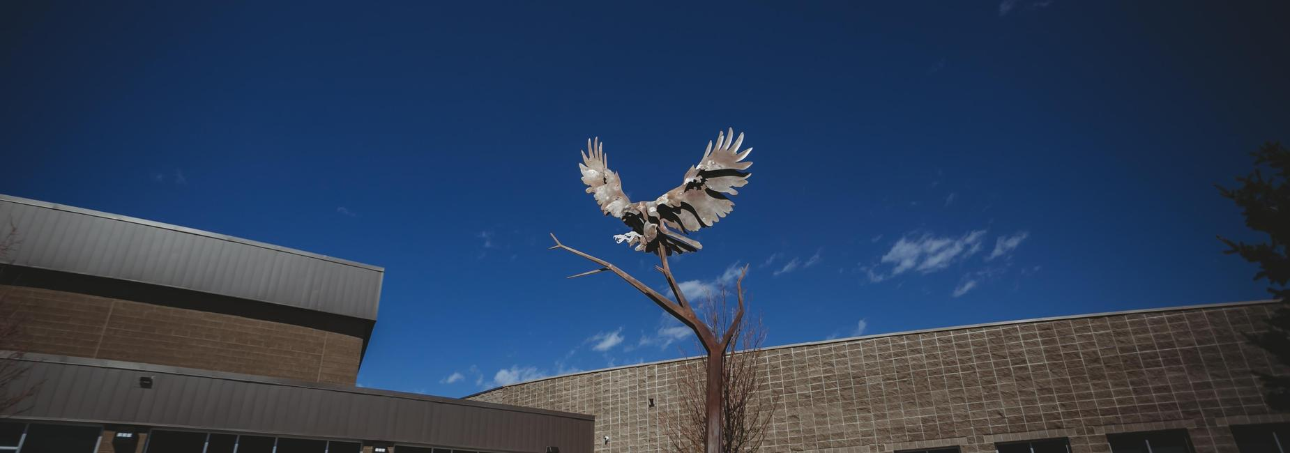 Hawk statue with sky background