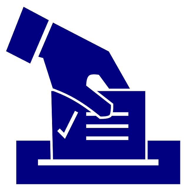 blue hand with ballot