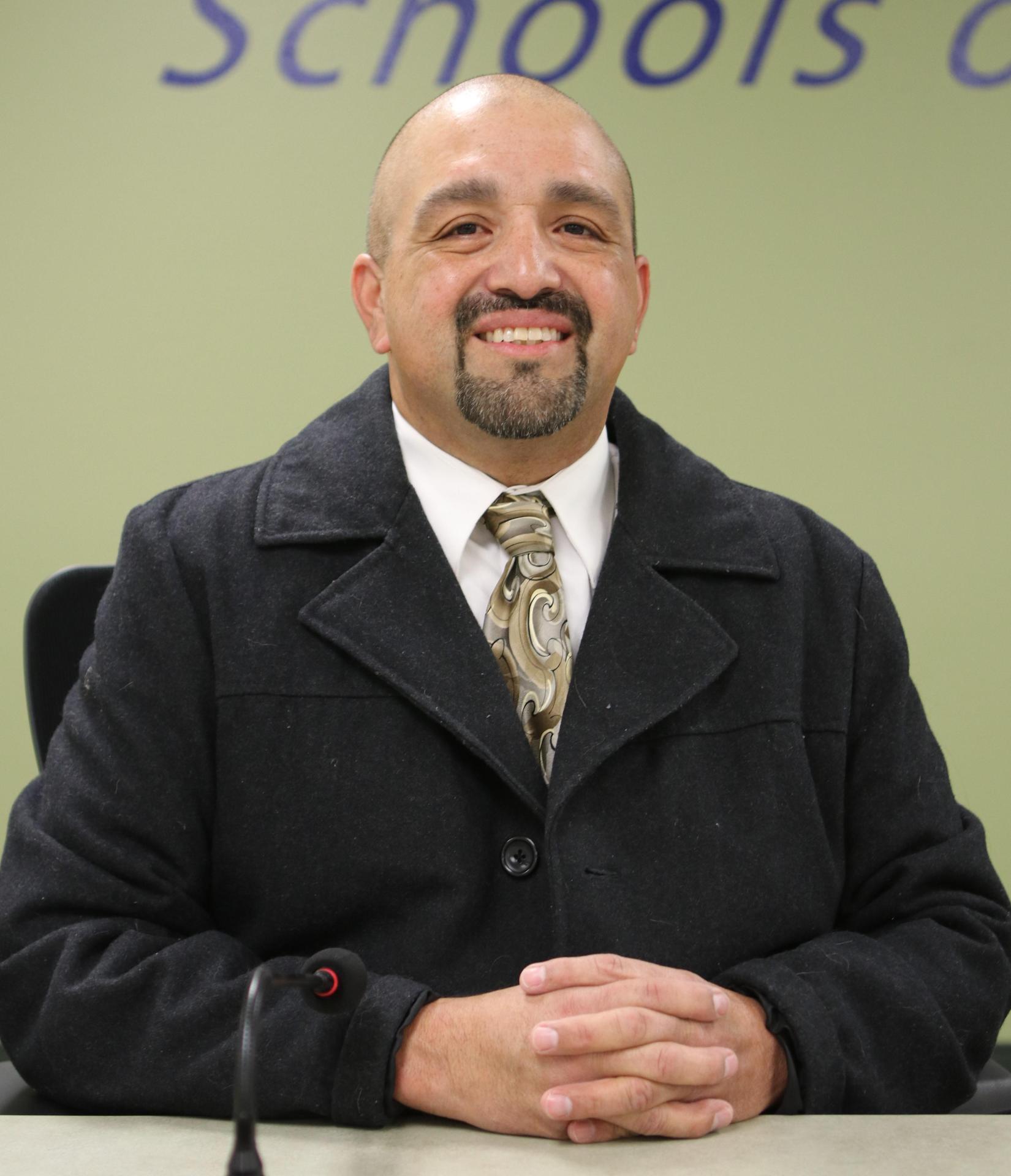 Trustee Manuel Godina