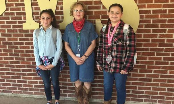 3 ladies dressed in western clothing
