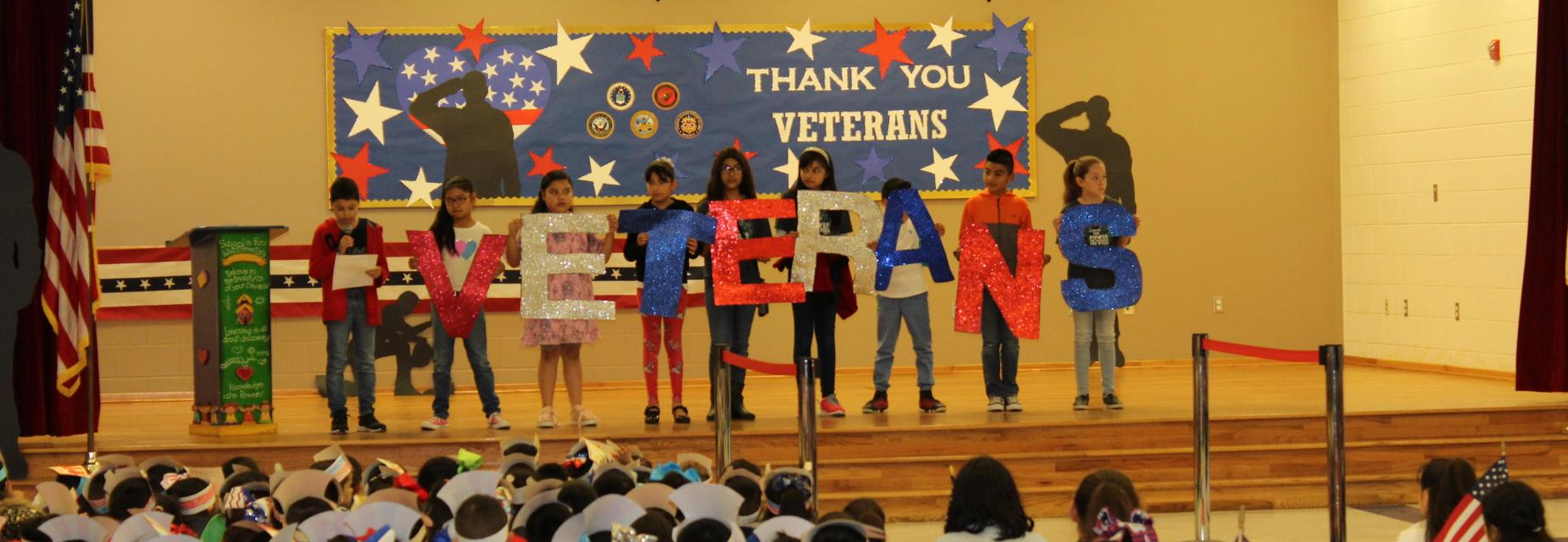 4th grade on stage for Veteran's Day program