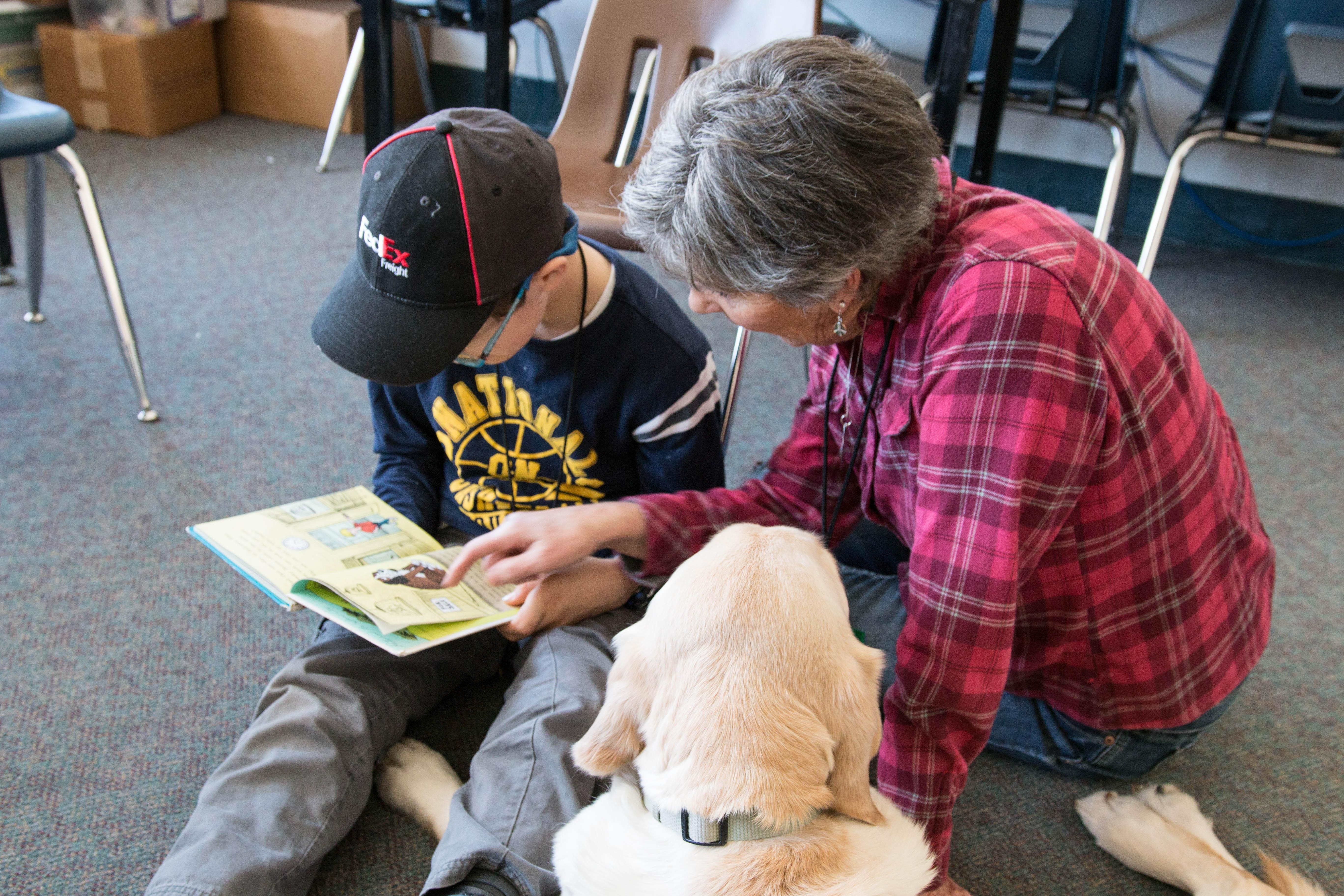 Student Reading with Therapy Dogs