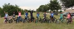 Ten elementary students won new bikes and helmets for earning perfect attendance and good citizenship in the 19th annual Lockheed Martin Bike Giveaway.