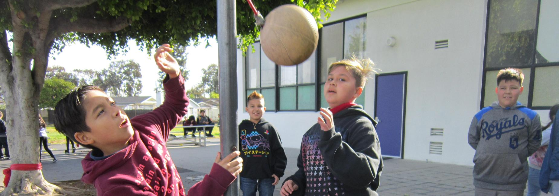 Students playing tetherball.