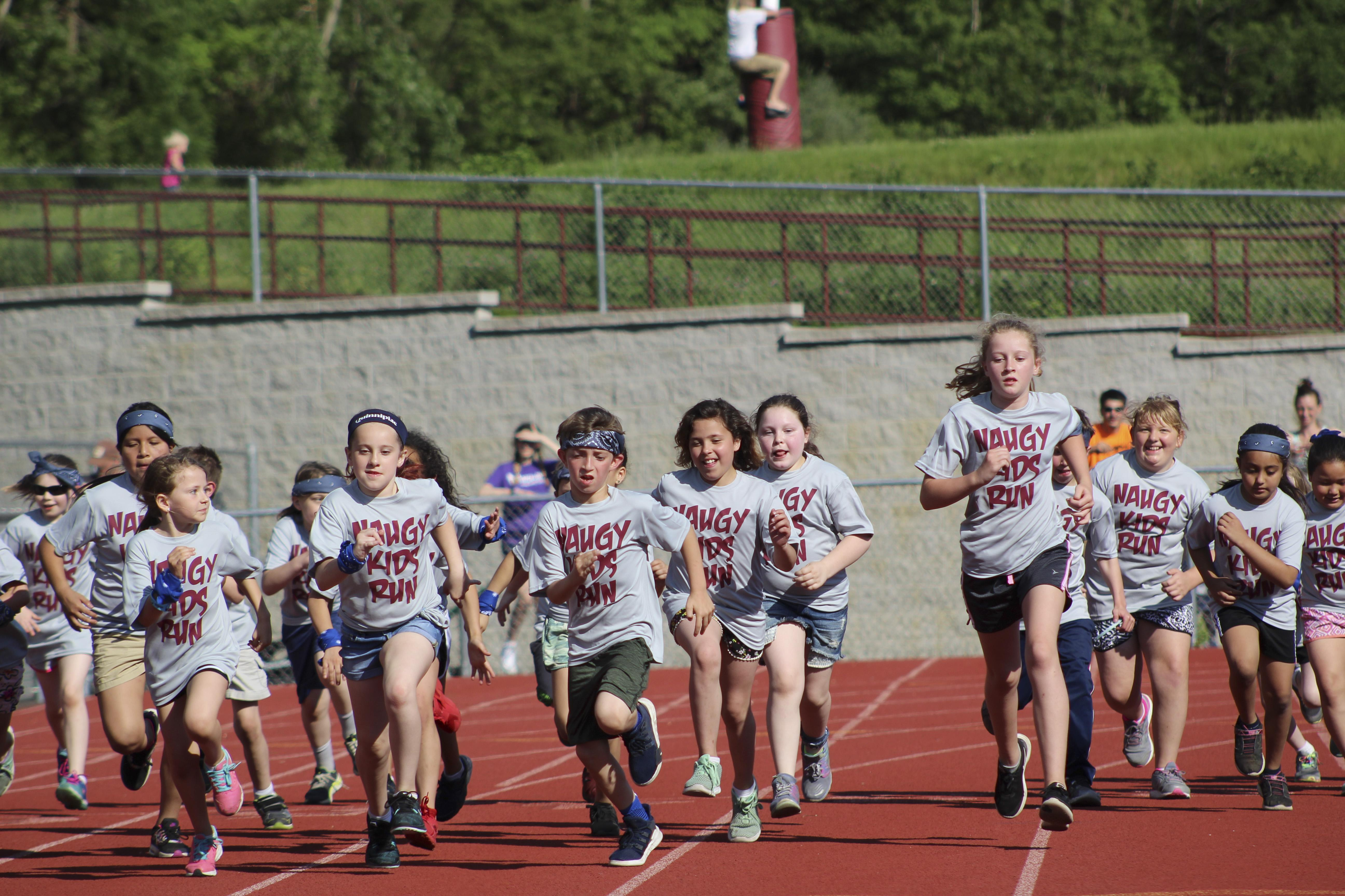Elementary students run on high school track