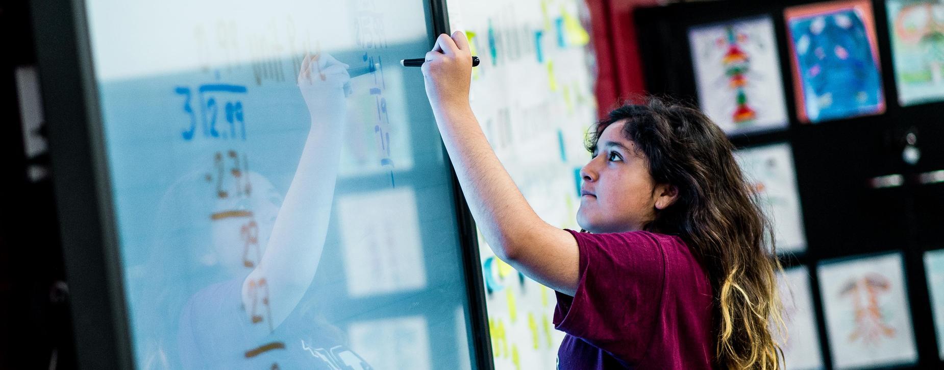 Girl using interactive board