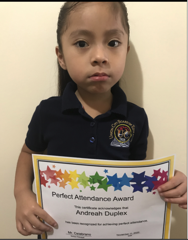 Andreah Duplex holding perfect attendance certificate