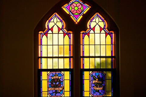 photo of stained glass window in OLSH Chapel