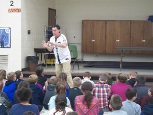 Hi-Toms representative talks to students.