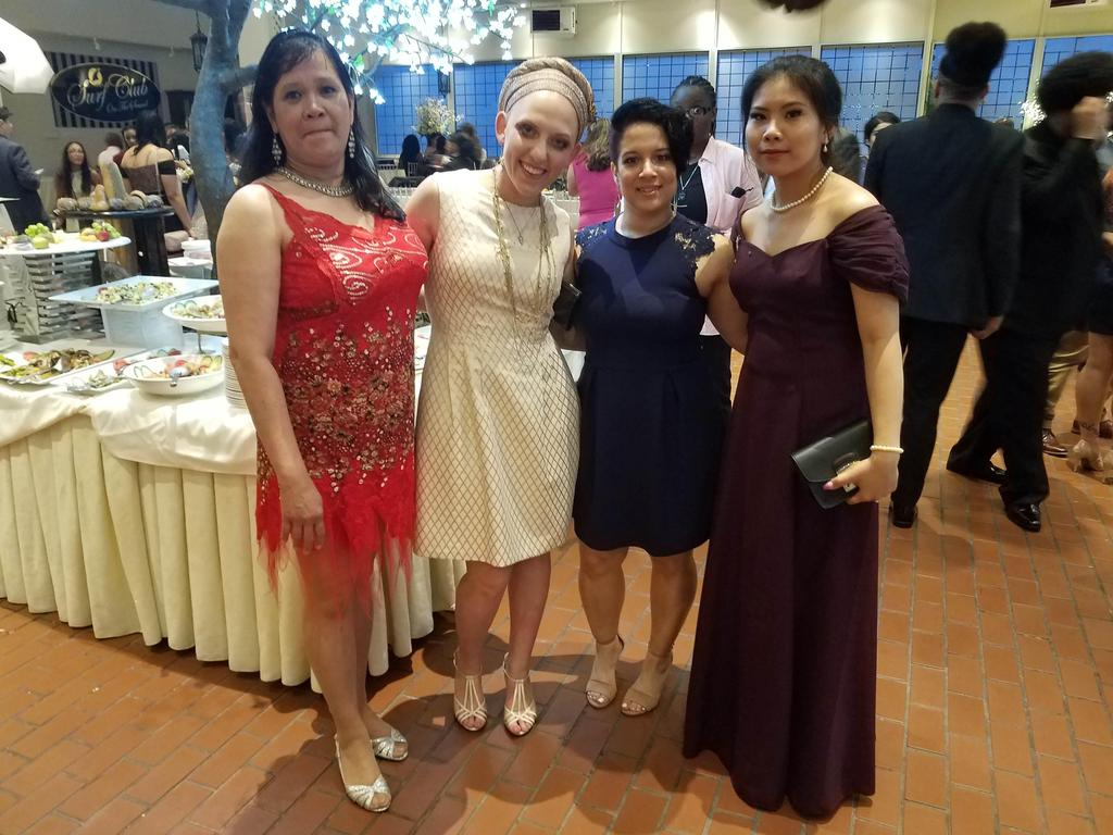 Ms.Sgueglia with three other teachers smiling