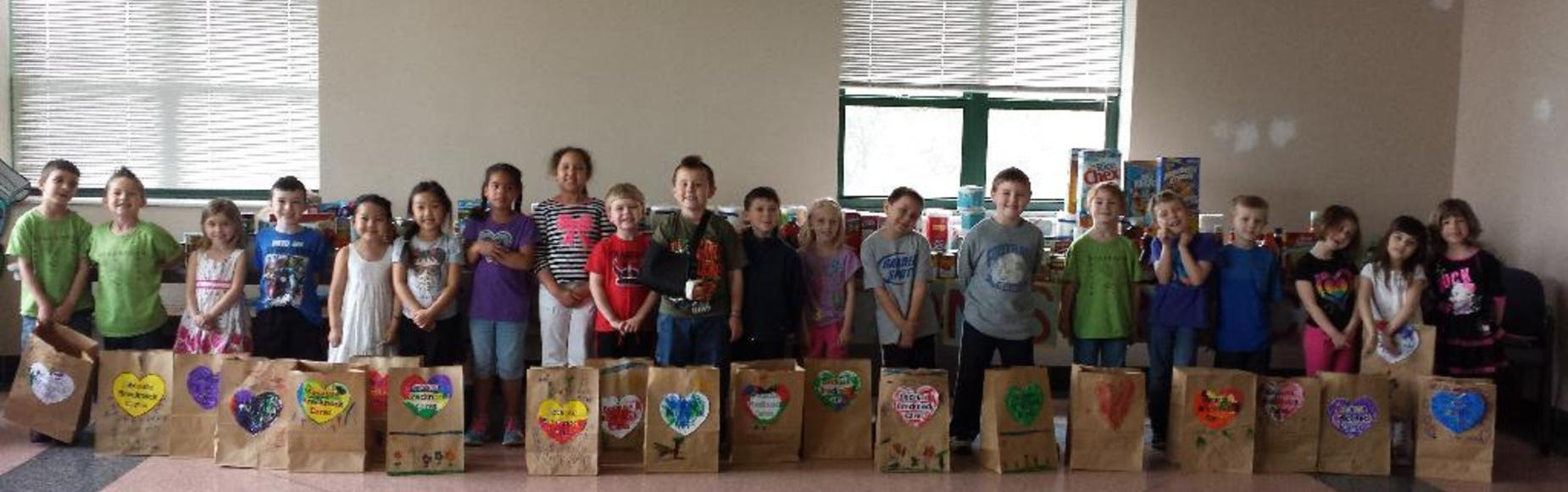 Students with Paper Bags Picture