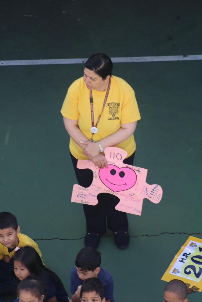hr 110 teacher holding their class puzzle piece