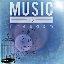 Music is freedom photo with music notes flying out of a cage.