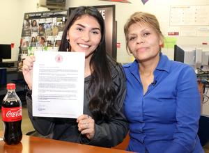 Edinburg High School Senior Brandy Rodriguez proudly holds the scholarship award letter from the Coca-Coca Scholars Foundation alongside her mother, Maria Rodriguez.