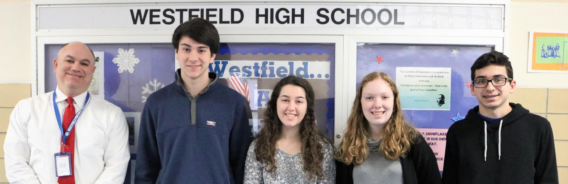 Photo of February 2019 ACT perfect scorers: Henry Meiselman (Science & STEM), Jacob Rock (English & Reading), Brianna Weber (Reading) and Abbey Zidel (English), pictured here with Westfield High School assistant principal James DeSarno.