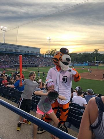 Kids get a picture with the Tiger mascot at the game.