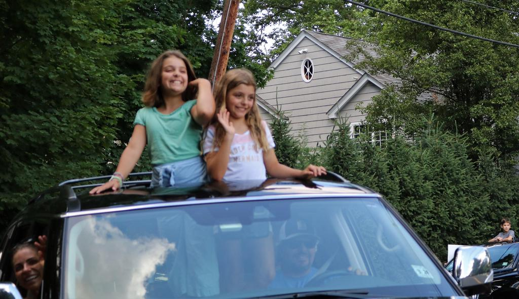 Photo of two Franklin students during Grade 5 Clap Out Car Parade.