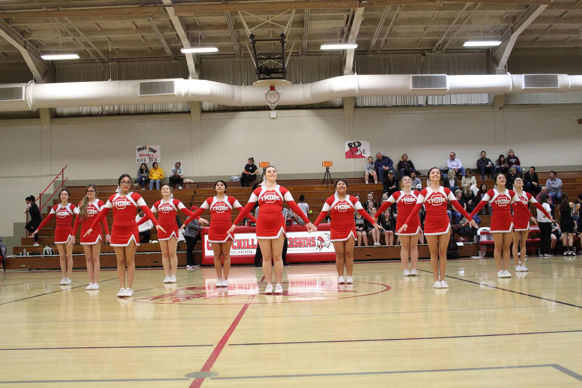 Cheer performing at Fresno Christian basketball game