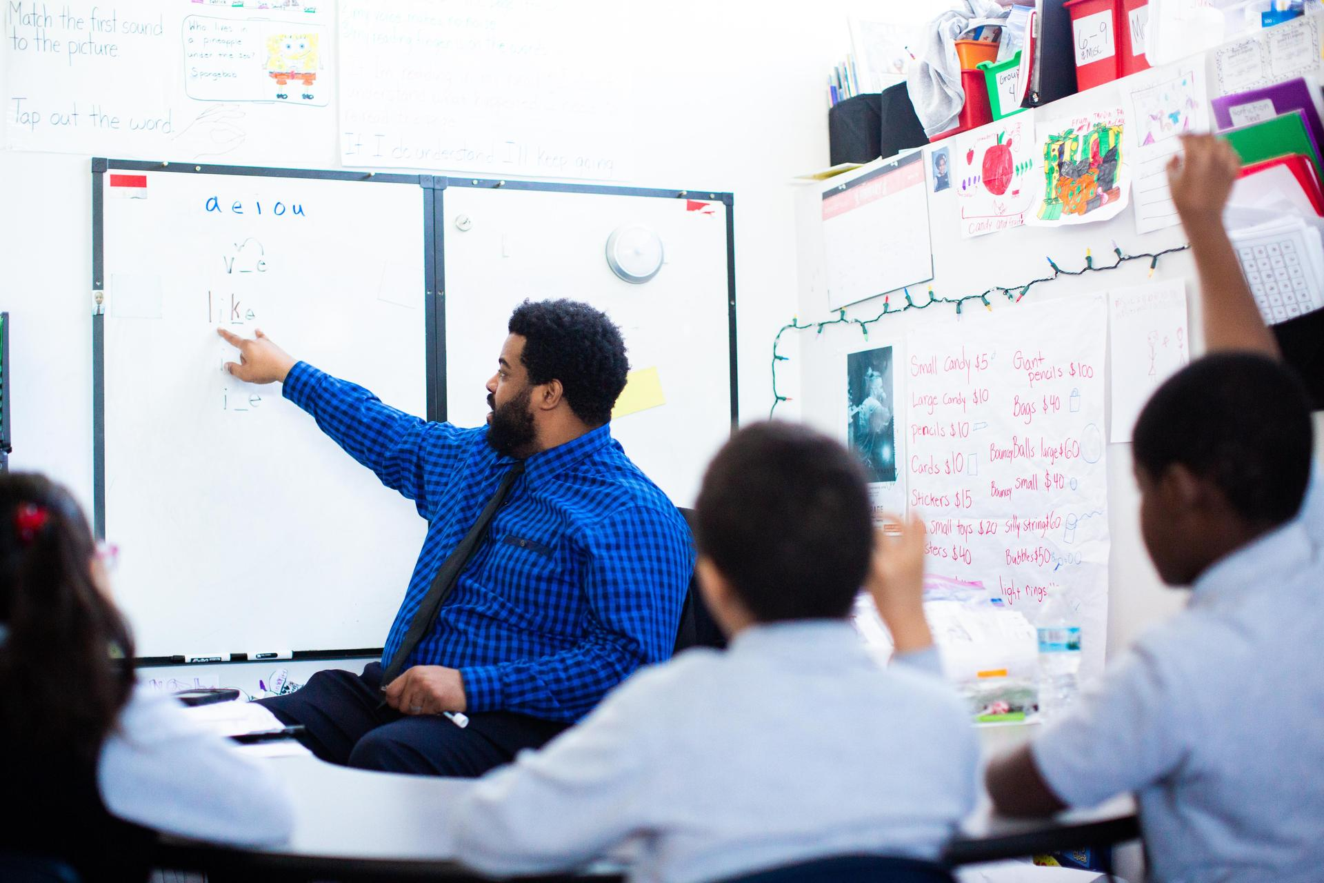Teacher pointing to board