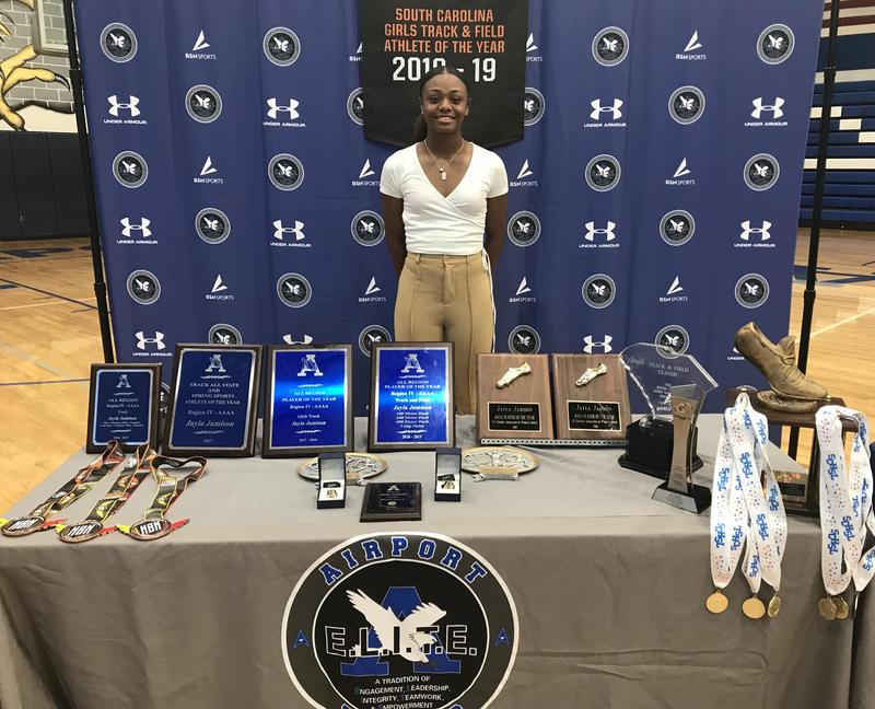 Jayla Jamison, with some of the state and national awards she has won from track and field.