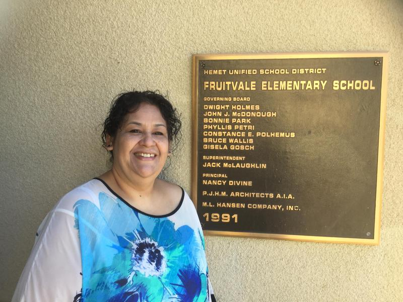 Beatriz Duran in front of a Fruitvale Elementary sign.