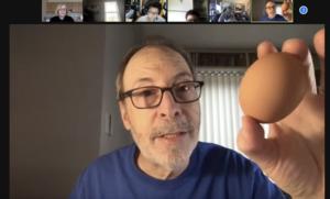 Dan Gutman in zoom spotlight showing egg