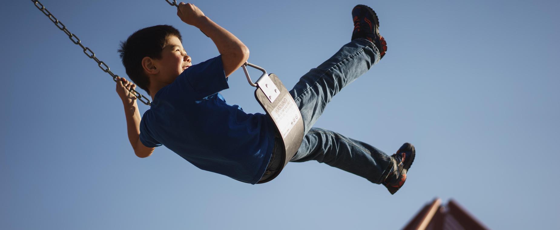 Child swinging on a playground swing