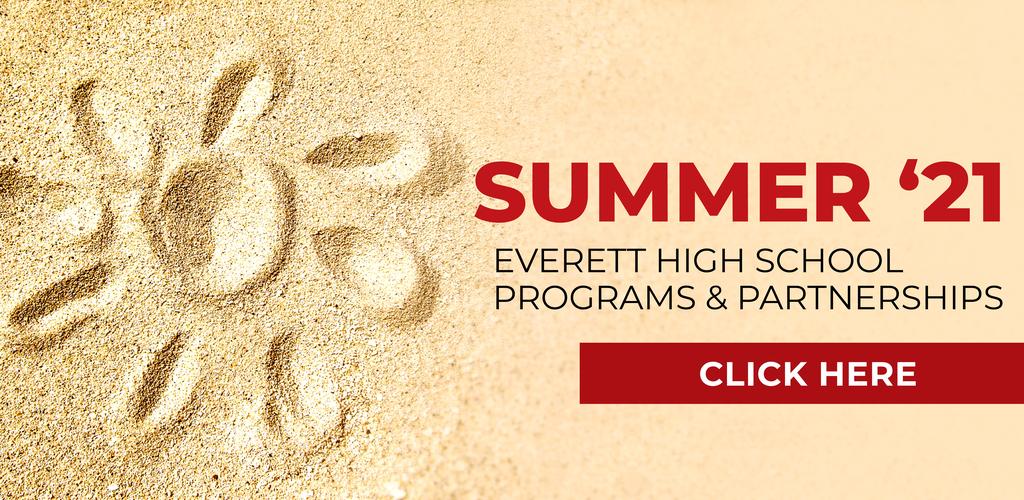 A sunburst imprint in golden sand, representing summer