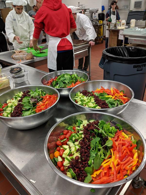 Salads being created in the South Lake Bistro