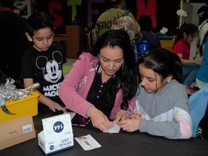 Baldwin Park Unified's Foster Elementary students and parents work together on science-themed challenges using household items during the school's fifth annual science, technology, engineering, arts and mathematics (STEAM) Family Night on Jan. 30.