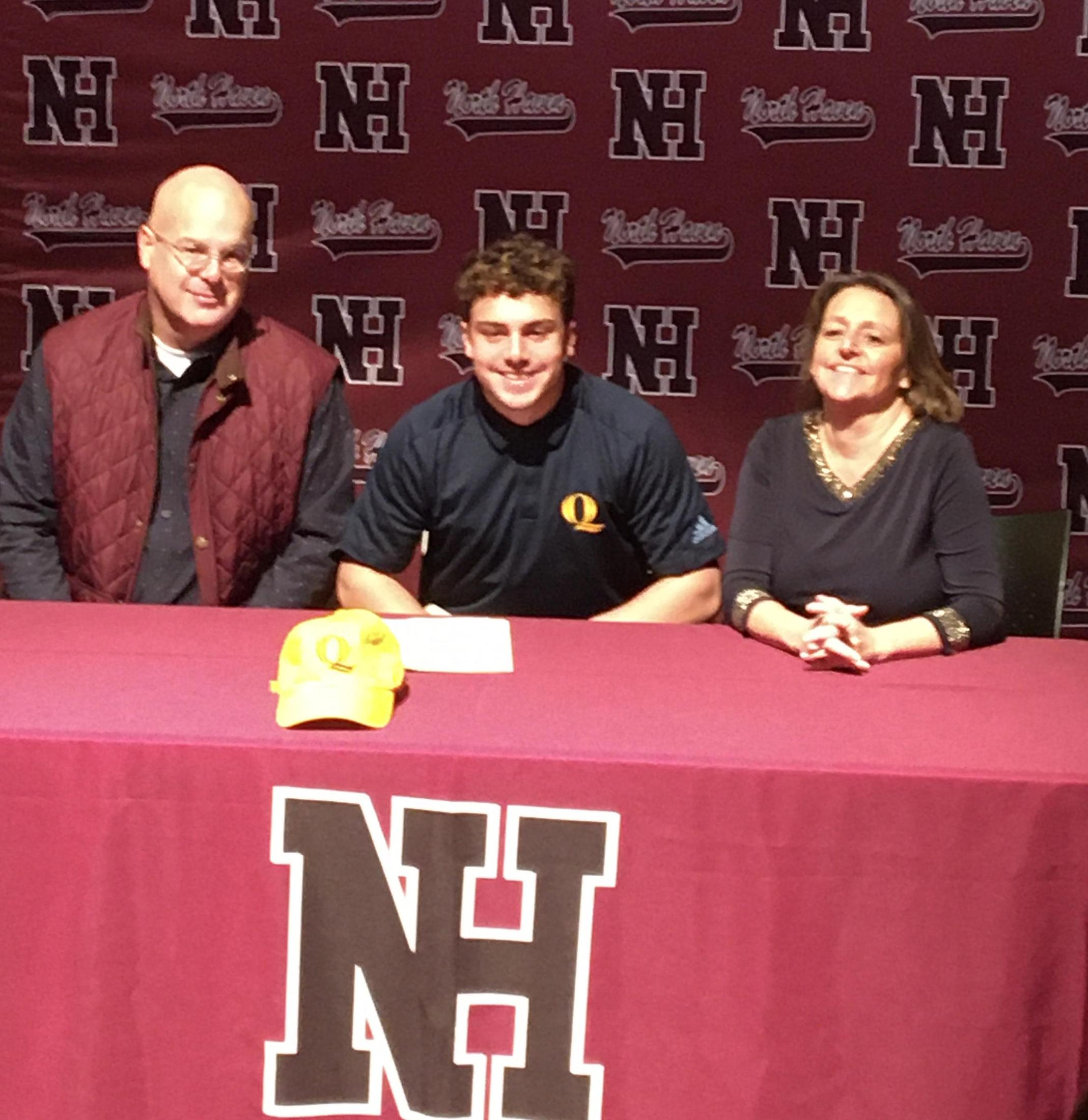 Matthew DeRosa with his parents after signing his NLI.