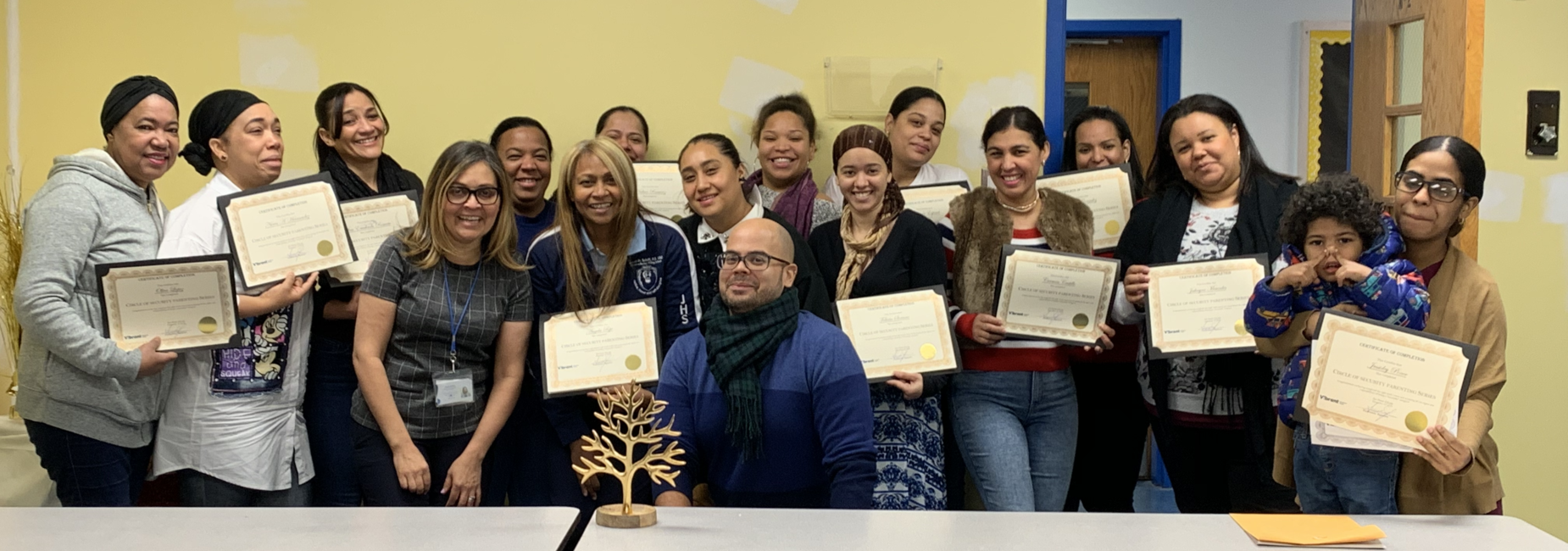 PARENTING CLASS GRADUATES WITH CERTIFICATES FROM VIBRANT